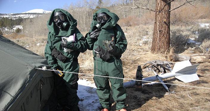 California National Guard troops in hazmat suits.