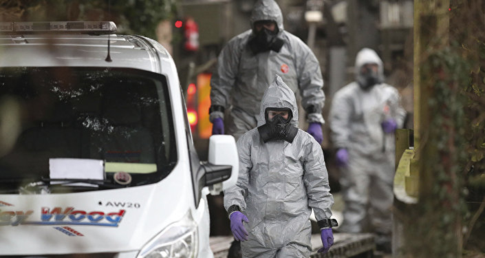 Investigators in protective clothing remove a van from an address in Winterslow, Wiltshire, as part of their investigation into the nerve-agent poisoning of ex-spy Sergei Skripal and his daughter, in England, Monday, March 12, 2018