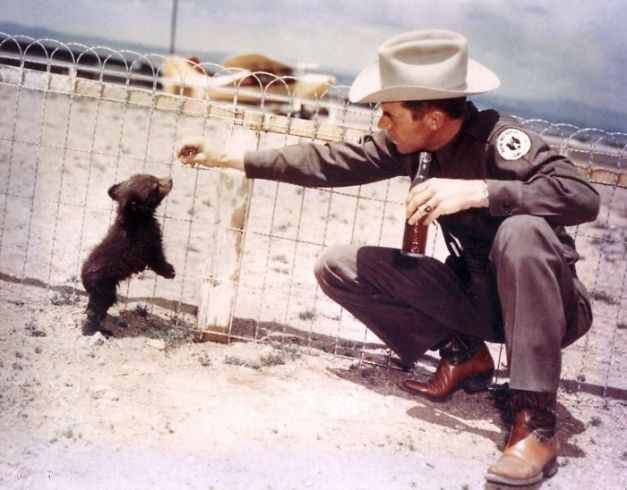 An Officer With Hot Foot Teddy, The Real-Life Inspiration For Smokey The Bear, 1950