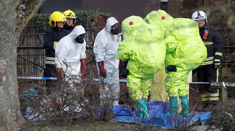 Officials in protective suits attend to the Skripal incident scene in Salisbury © Peter Nicholls