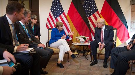 German Chancellor Angela Merkel and US President Donald Trump © Guido Bergmann