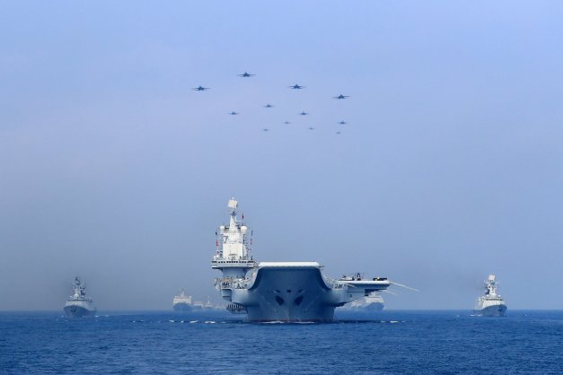 Warships and fighter jets of Chinese People's Liberation Army (PLA) Navy take part in a military display in the South China Sea April 12, 2018. Photo: Reuters/Stringer