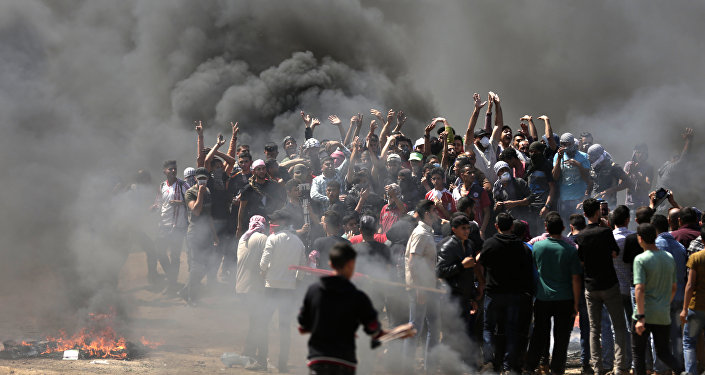 Palestinian demonstrators burn tyres near the Gaza-Israel border, east of Gaza City, as Palestinians readied for protests over the inauguration of the US embassy following its controversial move to Jerusalem on May 14, 0218