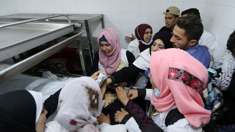 Colleagues of Palestinian nurse Razan Al-Najar react to her death © Ibraheem Abu Mustafa