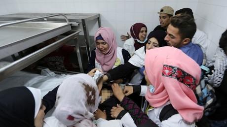 Colleagues of Palestinian nurse Razan Al-Najar react to her death © Ibraheem Abu Mustafa