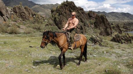 FILE PHOTO: Vladimir Putin rides a horse in southern Siberia's Tuva region August 3, 2009. © RIA Novosti/ Alexei Druzhinin