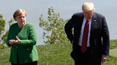 Germany's Chancellor Angela Merkel talks with US President Donald Trump at the G7 summit in Charlevoix, Quebec, Canada, on June 8, 2018. © Yves Herman