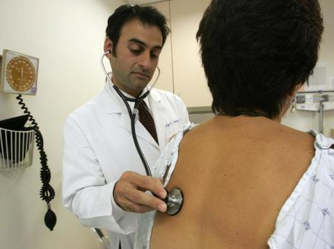 Dr. George Sawaya examines a person at the UCSF Women's Health Center in June 2006.