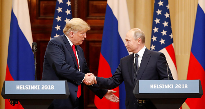 U.S. President Donald Trump and Russian President Vladimir Putin shake hands as they hold a joint news conference after their meeting in Helsinki, Finland July 16, 2018