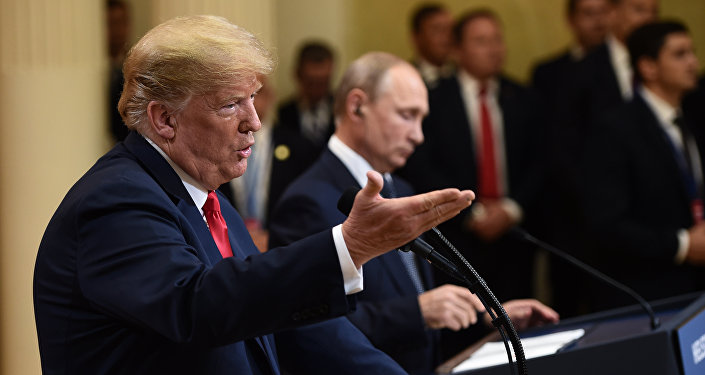 US President Donald Trump and Russia's President Vladimir Putin attend a joint press conference after a meeting at the Presidential Palace in Helsinki, on July 16, 2018