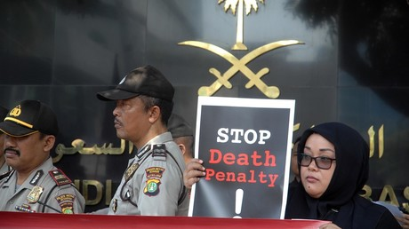FILE PHOTO Migrant worker activists demonstrate in front of the Saudi Arabian Embassy office in Jakarta