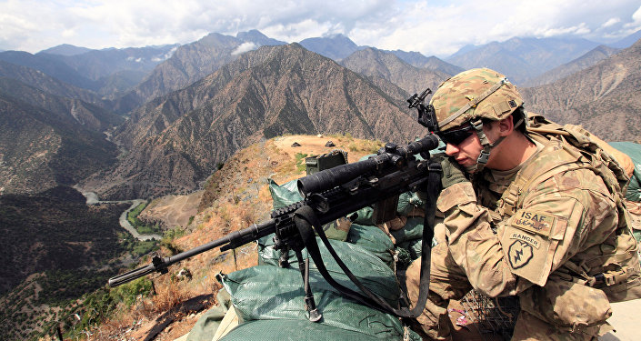 U.S. Army Lieutenant Edward Bachar looks trough his sniper scope at Observation Post Mace in eastern Afghanistan Kunar province, near the border with Pakistan (File)