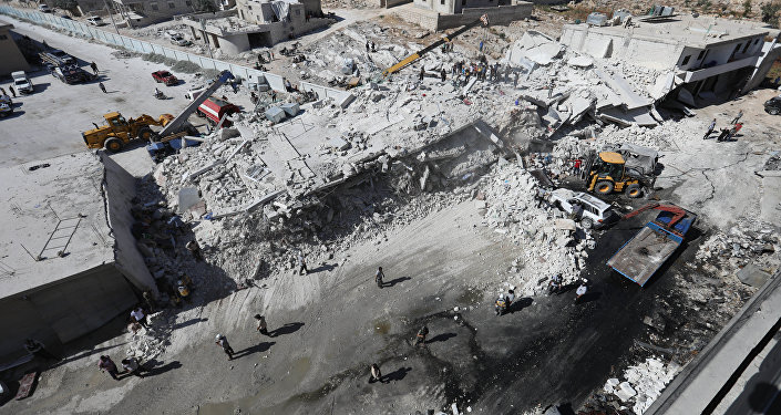Destroyed buildings are seen on August 12, 2018 following an explosion at an arms depot in a residential area in Syria's northern Idlib province city of Sarmada in which 12 people were reportedly killed.