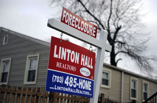 A Foreclosure Sign is Posted in the Front of a House in Alexandria Virginia Usa 17 December 2008 in a Move to Stimulate the Ever-weakening Us Economy Federal Reserve Cut Its Key Rate to a Historic Low Range of 0 to 0 25 Percent the Previous DayUsa Economy Housing - Dec 2008