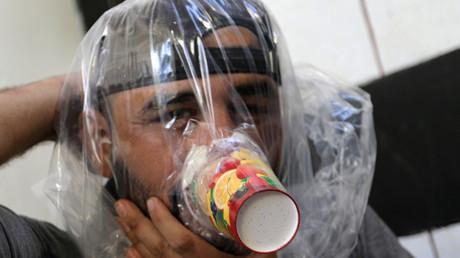 FILE PHOTO: A man tries an improvised gas mask in Idlib, Syria © Khalil Ashawi