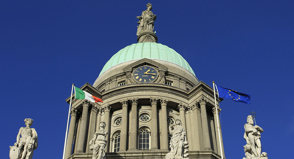 The Irish Flag flys alongside the European Union flag outside the Customs Building, Dublin , Ireland (File)