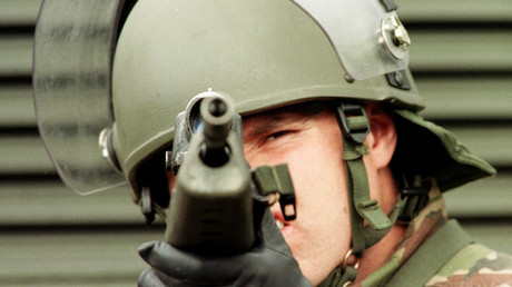 A British soldier peers down the sights of his gun on a morning patrol in East Belfast July 8, 1998. DJM/SB
