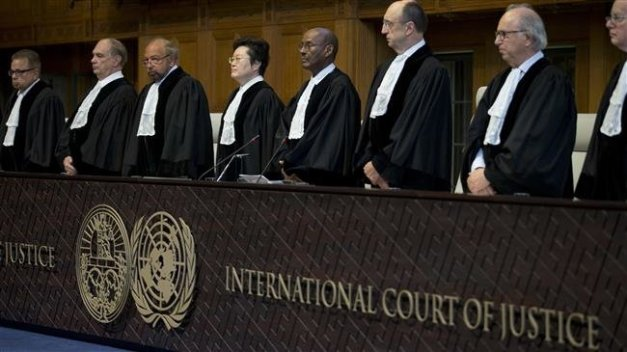 Judges enter the International Court of Justice, or World Court, in The Hague, Netherlands, Wednesday, Oct. 3, 2018, where they ruled on an Iranian request to order Washington to suspend US sanctions against Tehran. (Photo by AP)