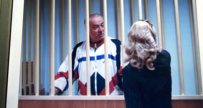 Aug. 9, 2006 file picture Sergei Skripal speaks to his lawyer from behind bars seen on a screen of a monitor outside a courtroom in Moscow