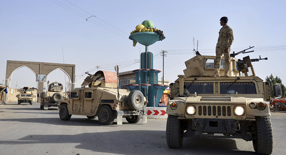 Aug. 12, 2018, photo, Afghan security personnel patrol in the city of Ghazni province west of Kabul, Afghanistan. A Taliban assault on Ghazni, a key city linking areas of Taliban influence barely 75 miles from Kabul, has killed about 100 Afghan policemen and soldiers since Friday, the Afghan Defense Ministry said