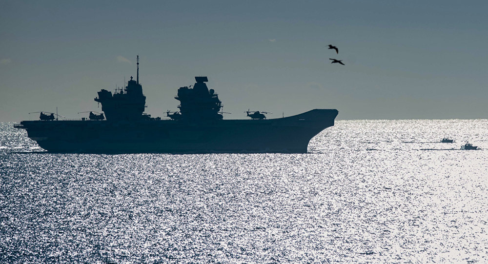 The 65,000-tonne HMS Queen Elizabeth, the largest warships ever built for the Royal Navy of the United Kingdom, arrives at the British territory of Gibraltar on Friday, Feb. 9, 2018