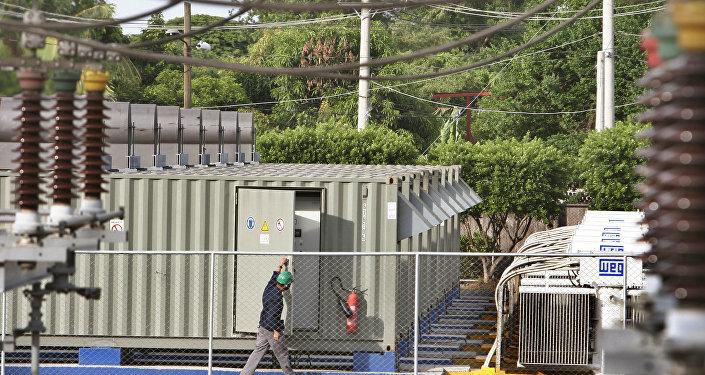 A worker checks an electrical generator from the Petroleos de Venezuela SA, or PVDSA. (File)