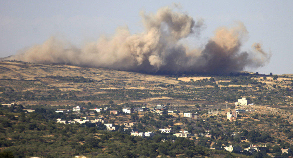 A picture taken from the Israeli-annexed Golan Heights shows smoke rising from the Syrian Druze village of Hader, on June 16, 2015
