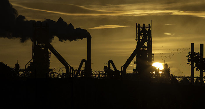 The sun rises behind the British Steel - Scunthorpe plant in north Lincolnshire, north east England on September 28, 2016