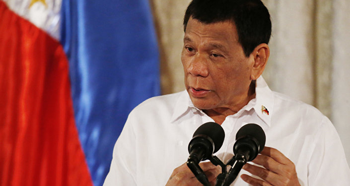 Philippine President Rodrigo Duterte addresses congressmen and government officials