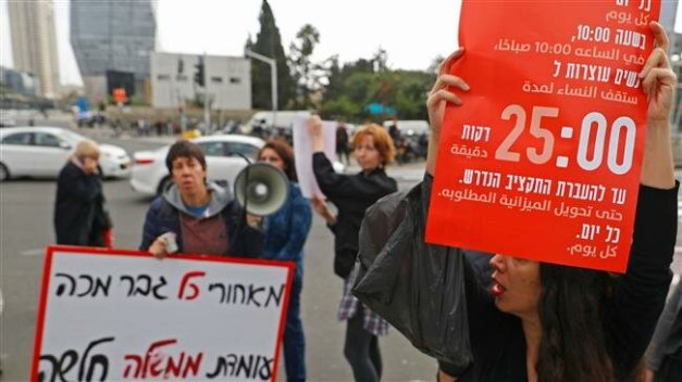 Israeli women take part in a rally against domestic violence in the city of Tel Aviv on December 12, 2018. (Photo by AFP)