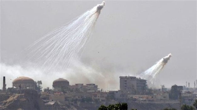 US warplanes use white phosphorus munitions in a strike on the then-Daesh controlled Iraqi city of Mosul on June 2, 2017. (Photo by AFP)