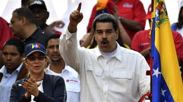 Venezuela's President Nicolas Maduro gestures during a rally at the Miraflores Presidential Palace in Caracas, Venezuela, on March 9, 2019. (Photo by AFP)