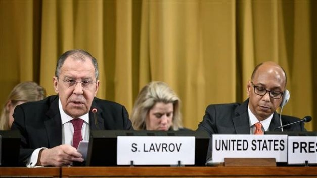 Russian Foreign Minister Sergei Lavrov (L) delivers a speech next to US ambassador Robert Wood during a session of the UN Conference for Disarmament on March 20, 2019 at the United Nations offices in Geneva. (Photo by AFP)