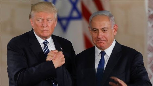 In this file photo taken on May 23, 2017 US President Donald Trump (L) and Israel's Prime Minister Benjamin Netanyahu shake hands after delivering a speech at the Israel Museum in Jerusalem. (Photo by AFP)