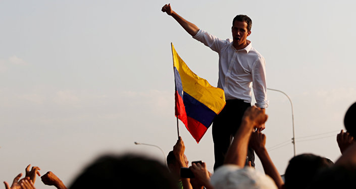 Venezuelan opposition leader Juan Guaido, who many nations have recognized as the country's rightful interim ruler, attends a rally in San Mateo Anzoategui, Venezuela March 22, 2019