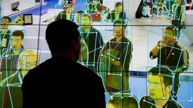 A man looks at a demonstration of human motion analysis software during the Security China 2018 exhibition on public safety and security in Beijing on October 24, 2018 [File: Reuters/Thomas Peter]