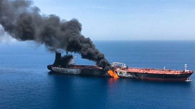 This photo shows fire and smoke billowing from Norwegian-owned Front Altair tanker said to have been attacked in the waters of the Sea of Oman on June 13, 2019. (Photo by ISNA)