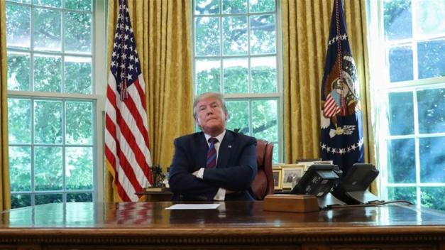 US President Donald Trump takes questions from the media in the Oval Office on July 26 [Reuters/Leah Millis]