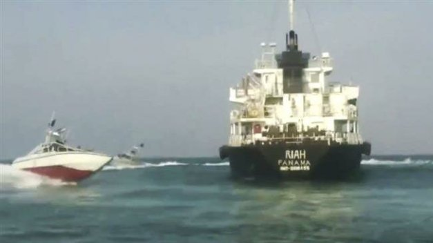 This image grab shows IRGC Navy speedboats maneuvering around MT Riah, an Emirati tanker seized by Iran over smuggling Iranian fuel.