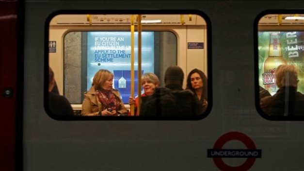 People are seen on train on the London Underground. (File photo by AFP)