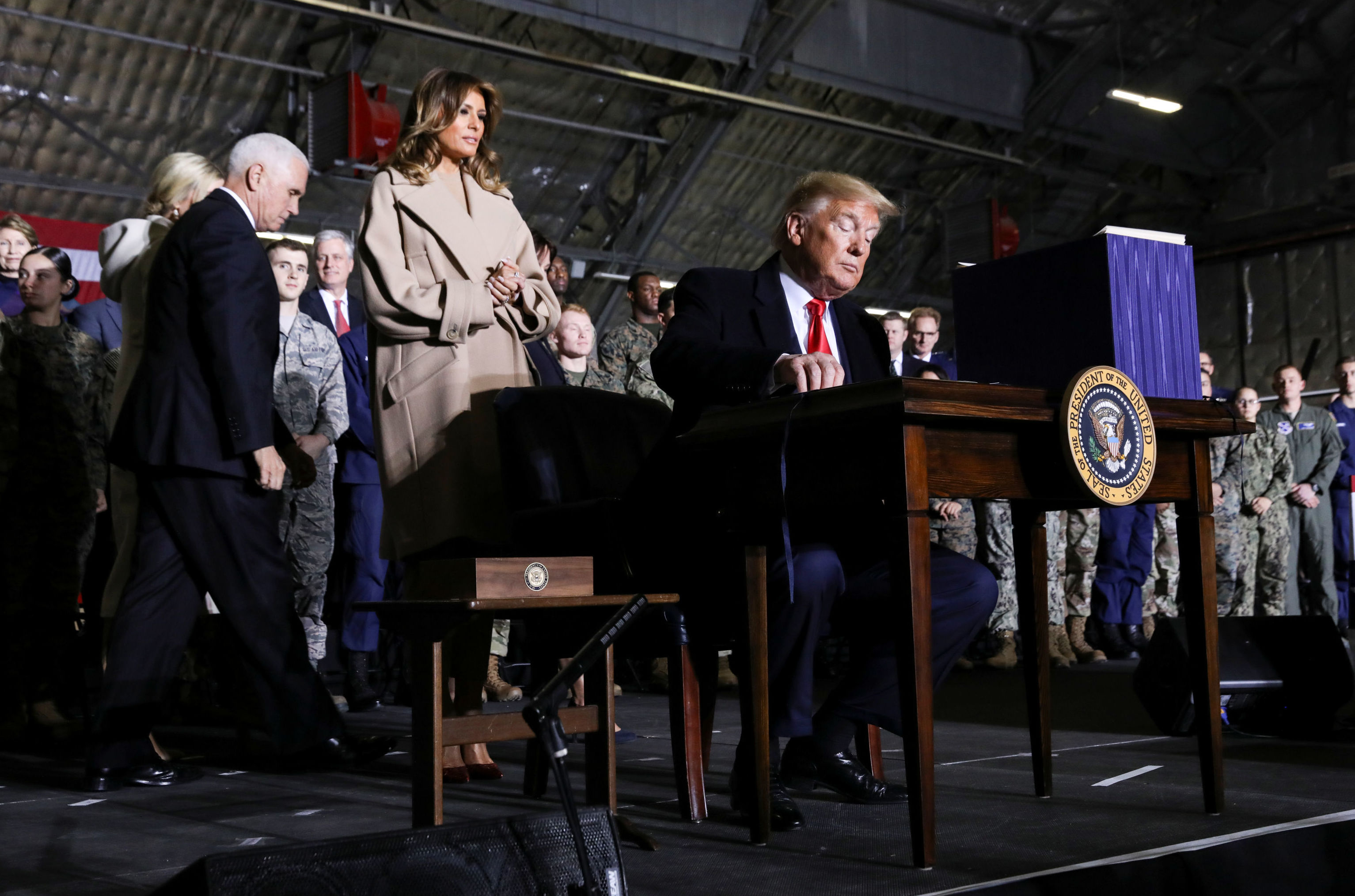 U.S. President Donald Trump prepares to sign the National Defense Authorization Act for Fiscal Year 2020