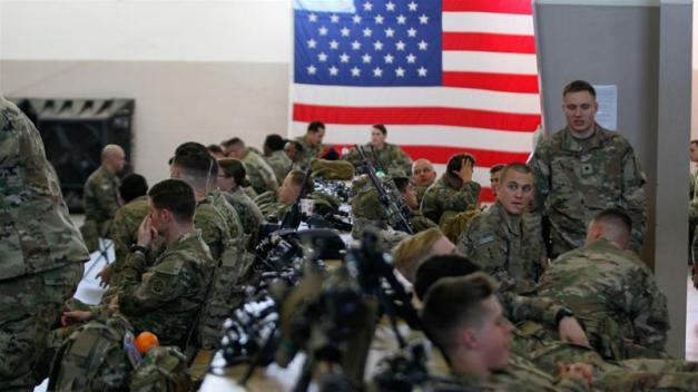 US army paratroopers assigned to 1st Brigade Combat Team prepare to board an aircraft bound for the US Central Command area of operations from North Carolina [File: Reuters]